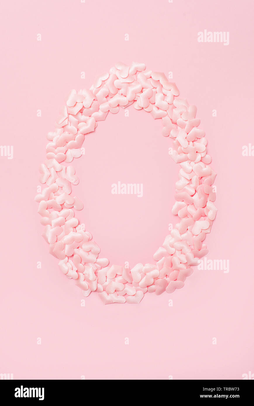 Number zero collected from decorative pink hearts. Isolated on pink background - Stock Image