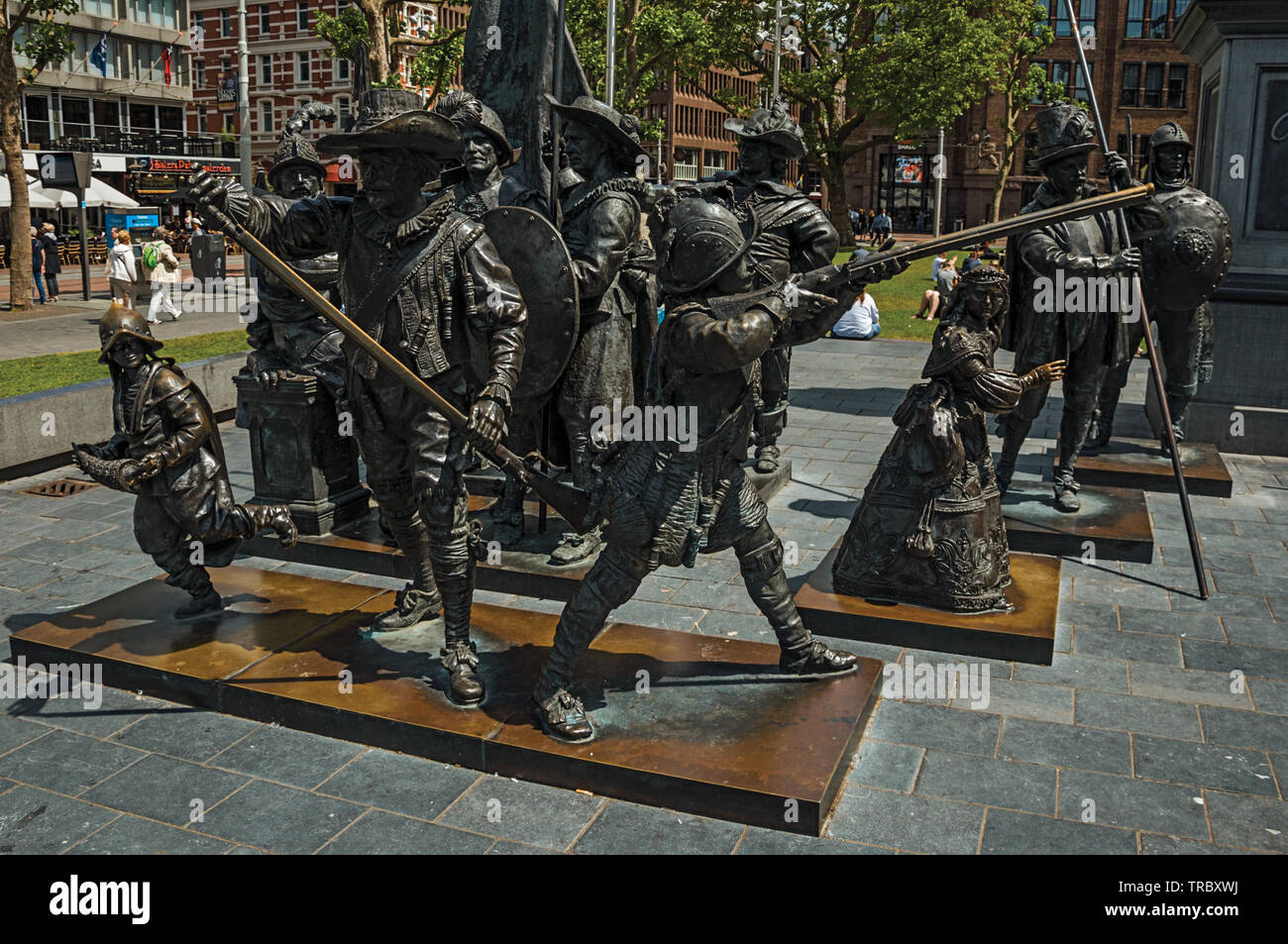 Rembrandt Square with sculptures from the Night Watch picture in Amsterdam. City with huge cultural activity, canals and bridges in Netherlands. Stock Photo