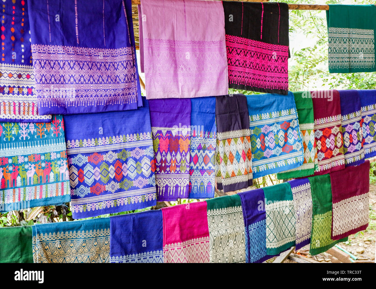 Traditional thai and Laos Sarong asian colorful on clothes line / woven silk shop - Stock Image