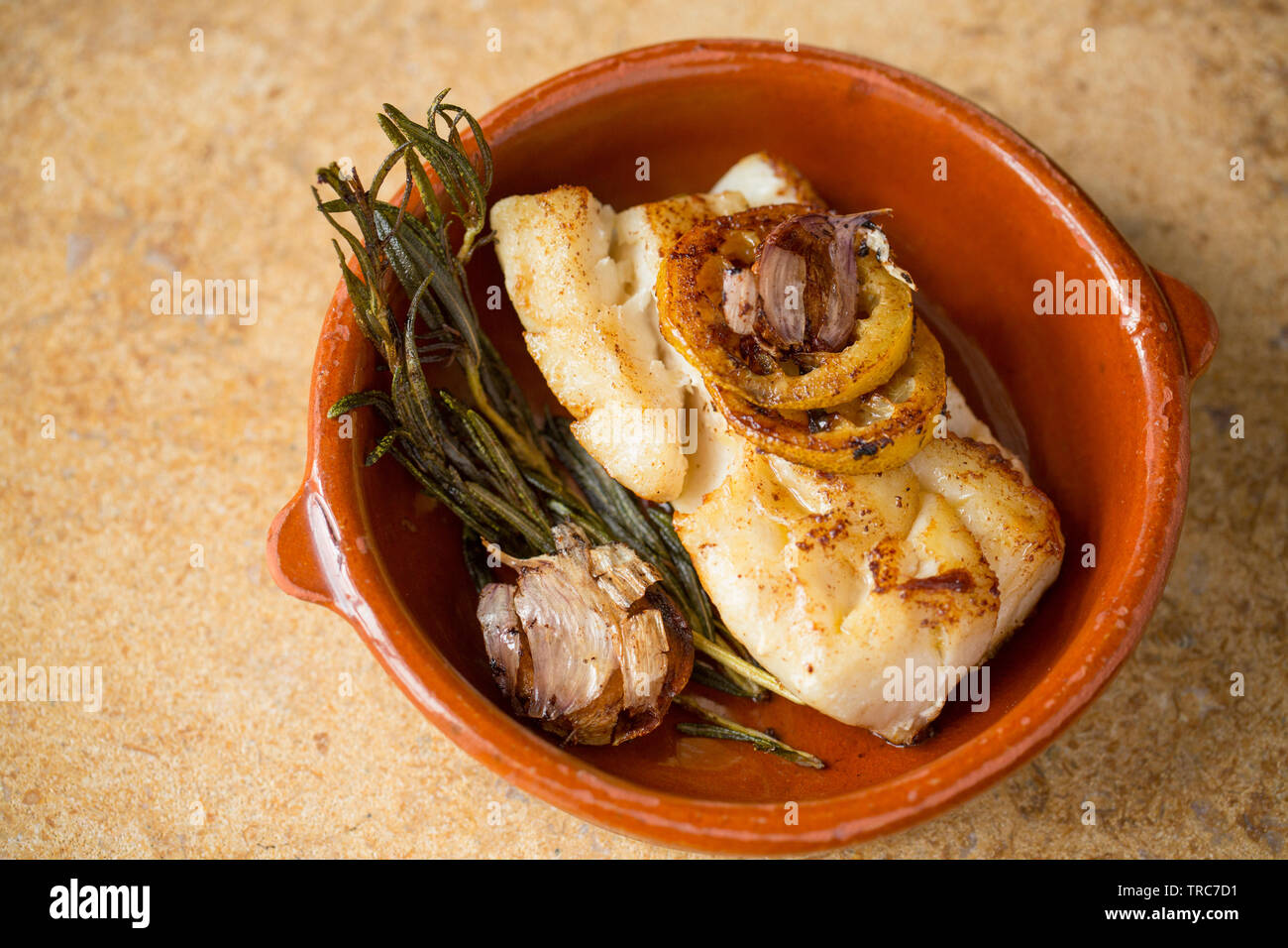A cooked, thick fillet of pollack, Pollachius pollachius, that was caught on rod and line from a boat in the English Channel. It has been fried in oil - Stock Image