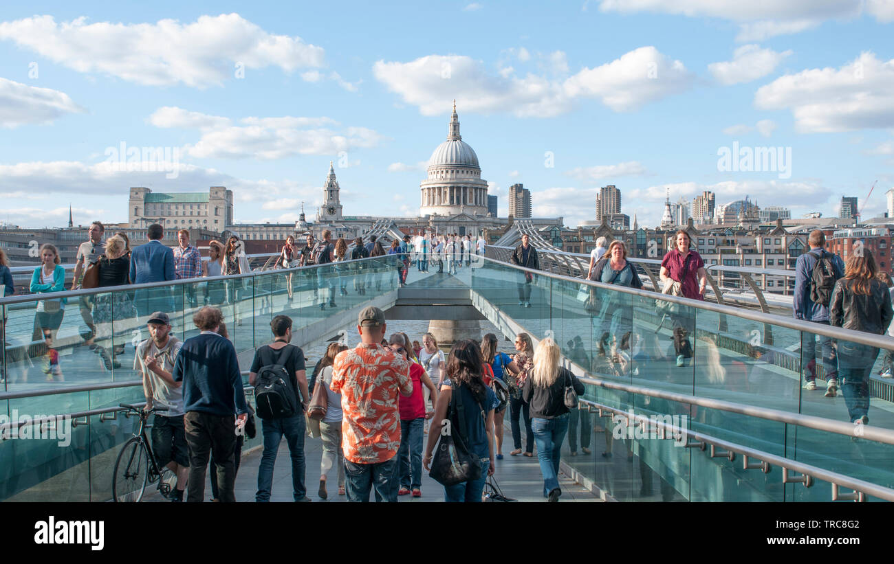 LONDON, UNITED KINGDOM - JUNE 03, 2019 - People walk on the Millennium Bridge towards St. Paul's Cathedral - Stock Image