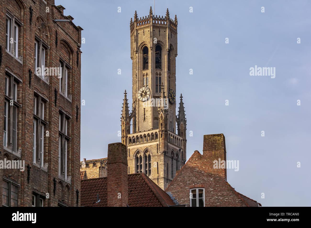 Belfry of Bruges, the medieval bell tower against blue sky. The 83 meter high belfry or hallstower (halletoren) is Bruges' most well-known landmark Stock Photo