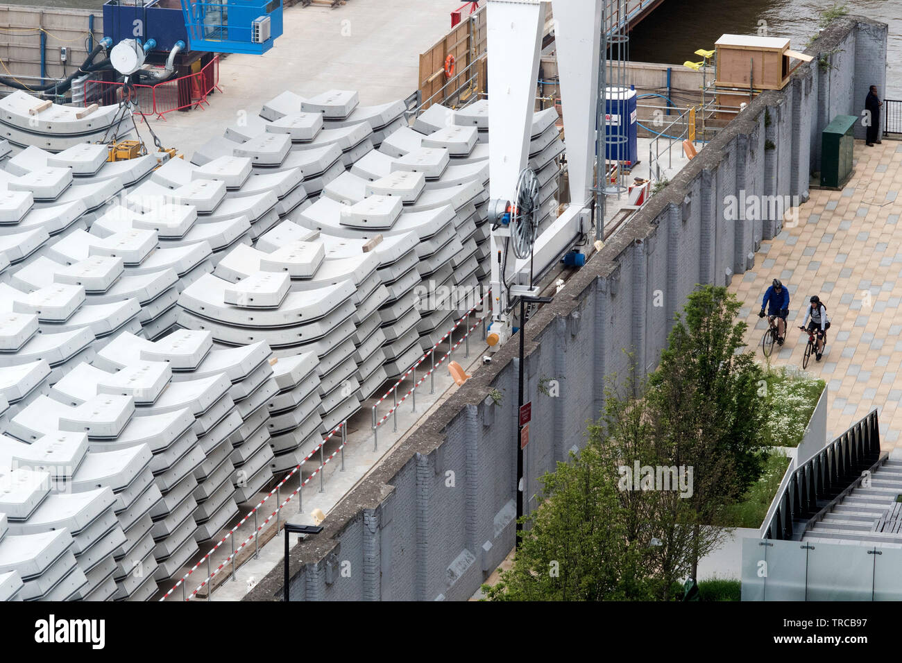 Concrete tunnel segments being delivered by barge at Thames Tideway super sewer site at Battersea Power Station in London. 31/5/19. - Stock Image