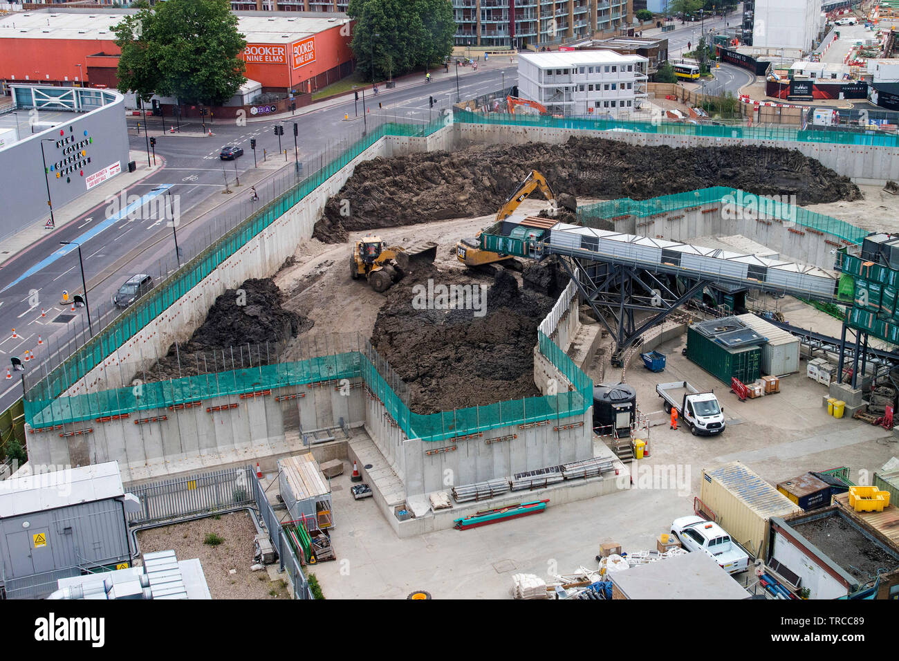 Diggers move mud from the Thames Tideway super sewer site at Battersea Power Station in London. 31/5/19. - Stock Image