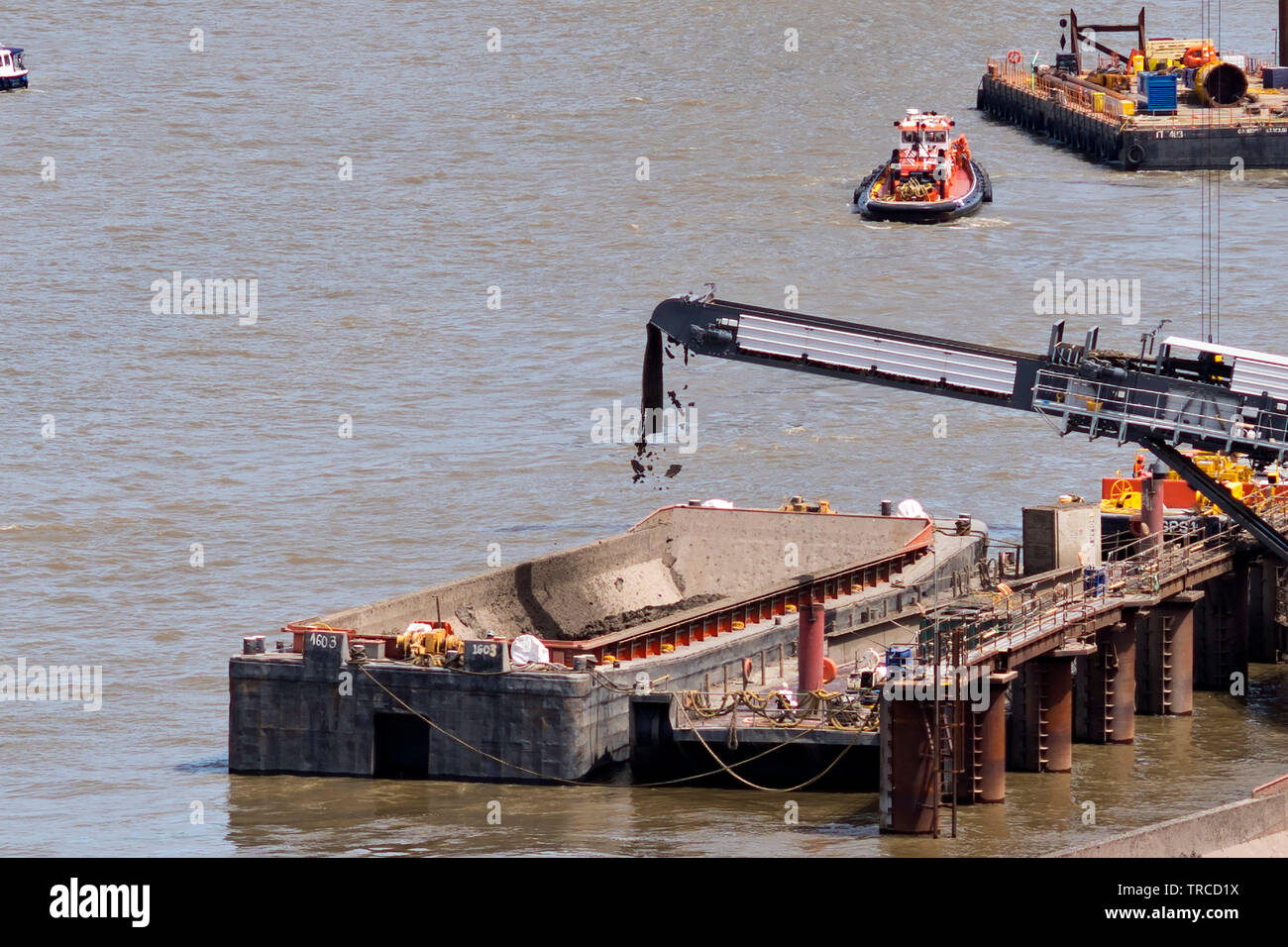 Earth from the Thames Tideway Tunnel is loaded onto a barge on the river Thames at Battersea Power Station.  31/5/2019 - Stock Image