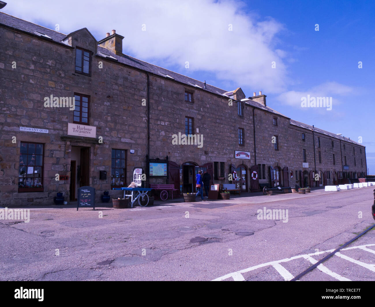 Shops and cafes alongside Lossiemouth new harbour Moray Speyside Northern Scottish Highlands on Moray Coast Trail - Stock Image