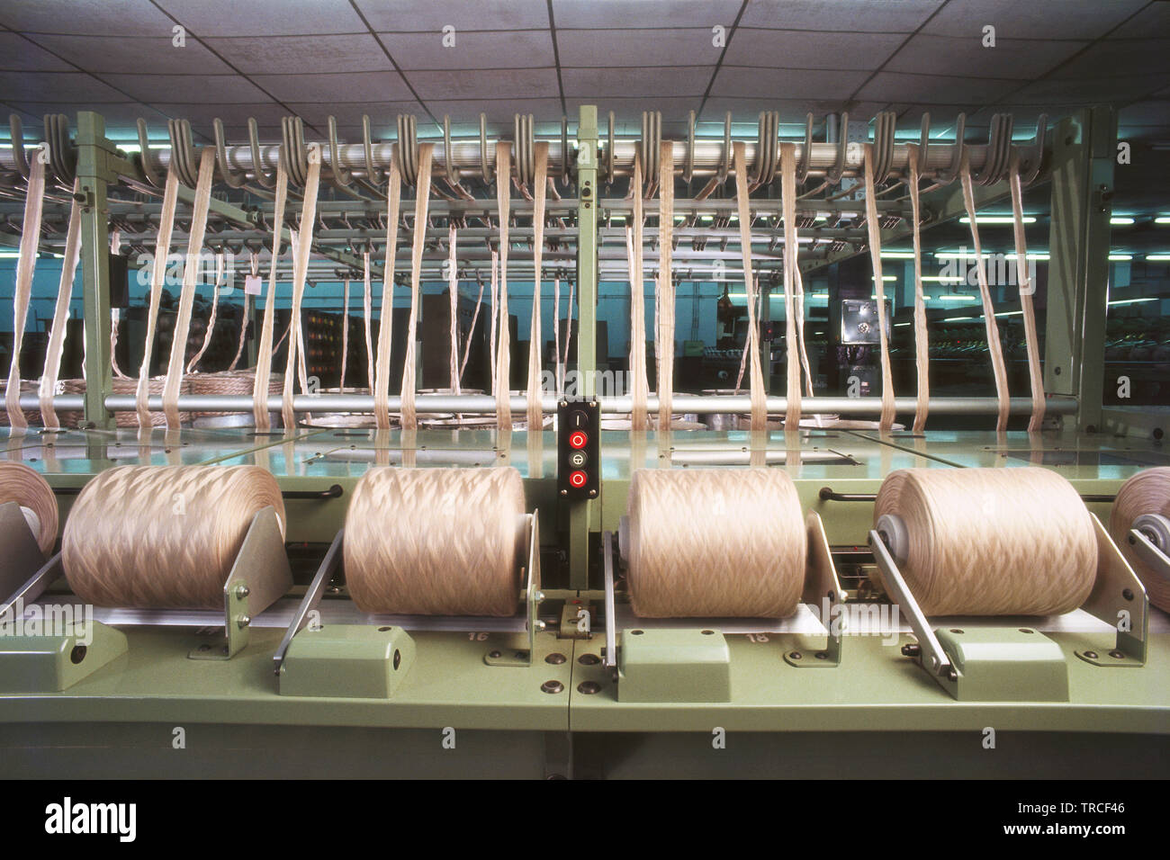TEXTILE WEAVING MACHINE IN A TEXTILE MILL, INDIA - Stock Image