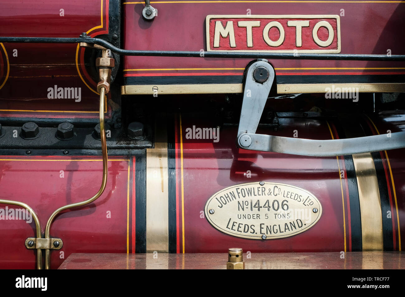 Side view of a red, vintage steam traction engine - Stock Image