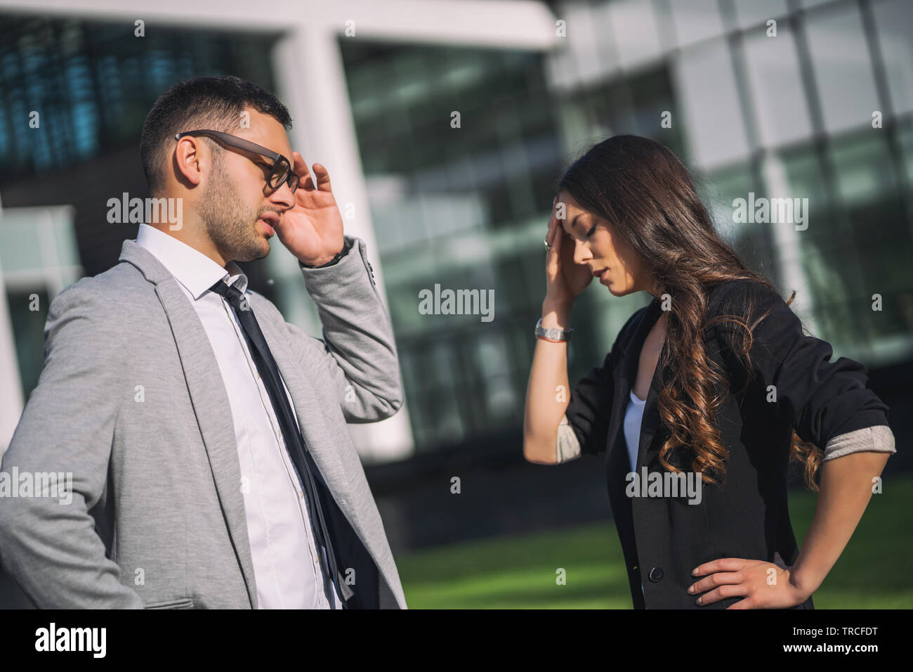 Overworked business people is talking to colleague after work. - Stock Image