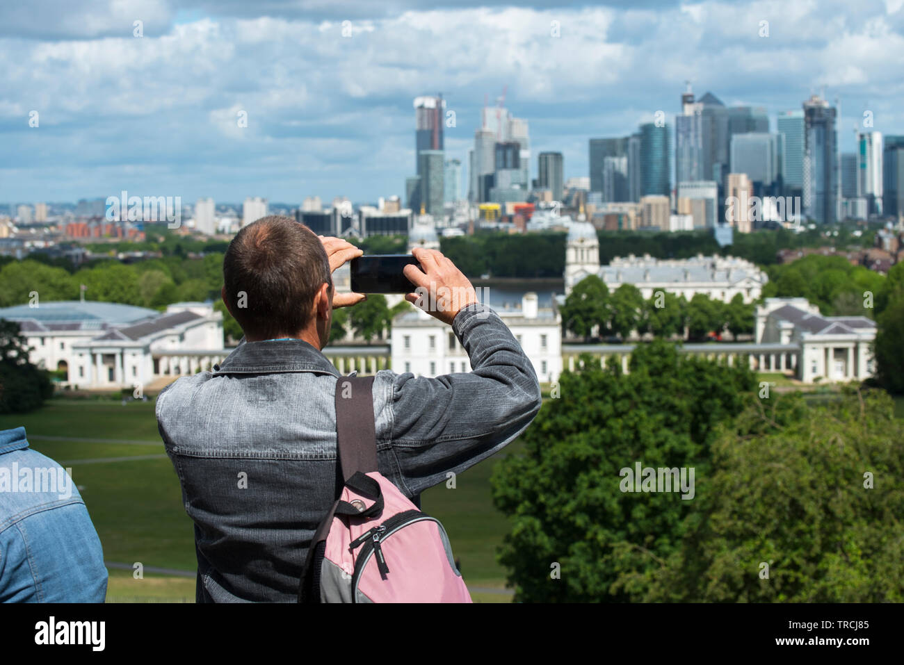 London England UK. Canary Wharf and Queen's House Greenwich photographed from Greenwich Park in South East London. May 2019 Stock Photo