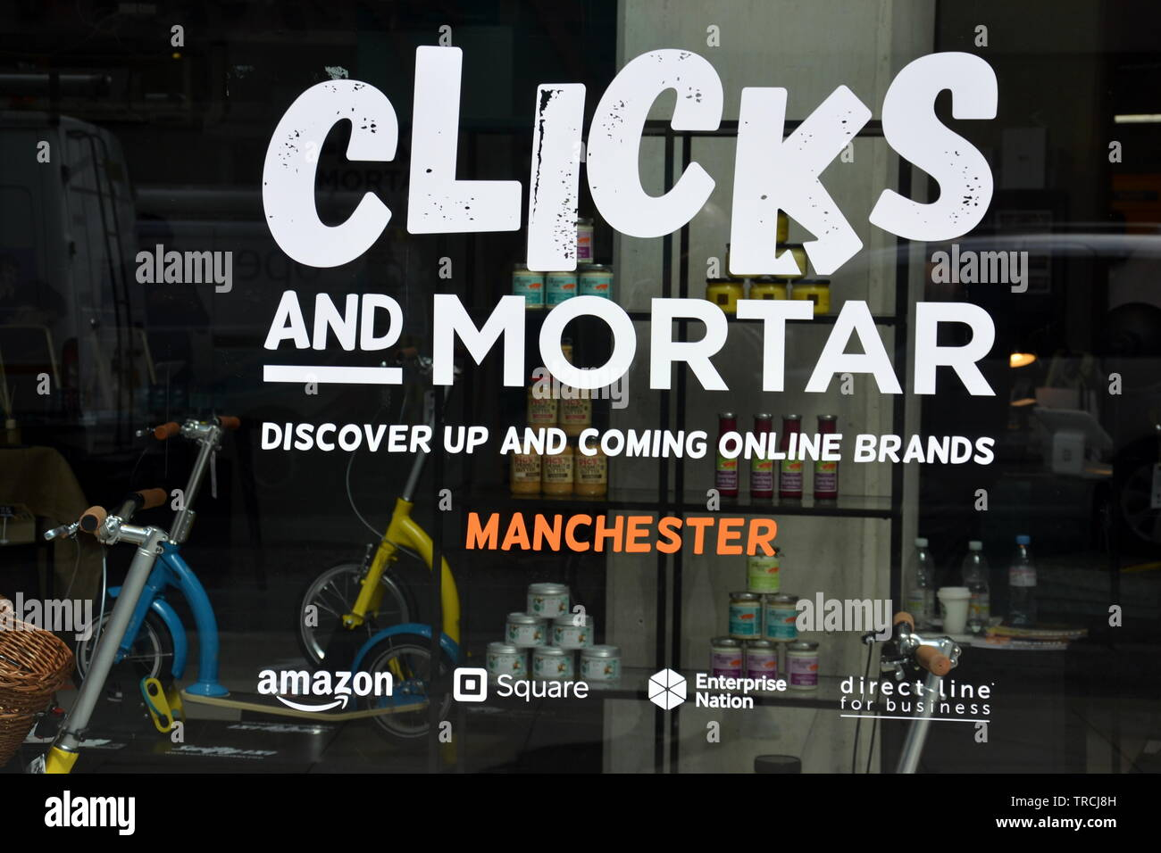 June 3rd, 2019.  Amazon and Enterprise Nation started a new initiative today to  help small businesses sell on the high street.  They plan to open ten 'Clicks and Mortar' shops in the uk as a one year pilot project.  The first shop opened today on St Mary's Gate in city centre Manchester. The shops aim to help selected online brands grow their high street presence. The shop window of the new shop in Manchester, uk. - Stock Image