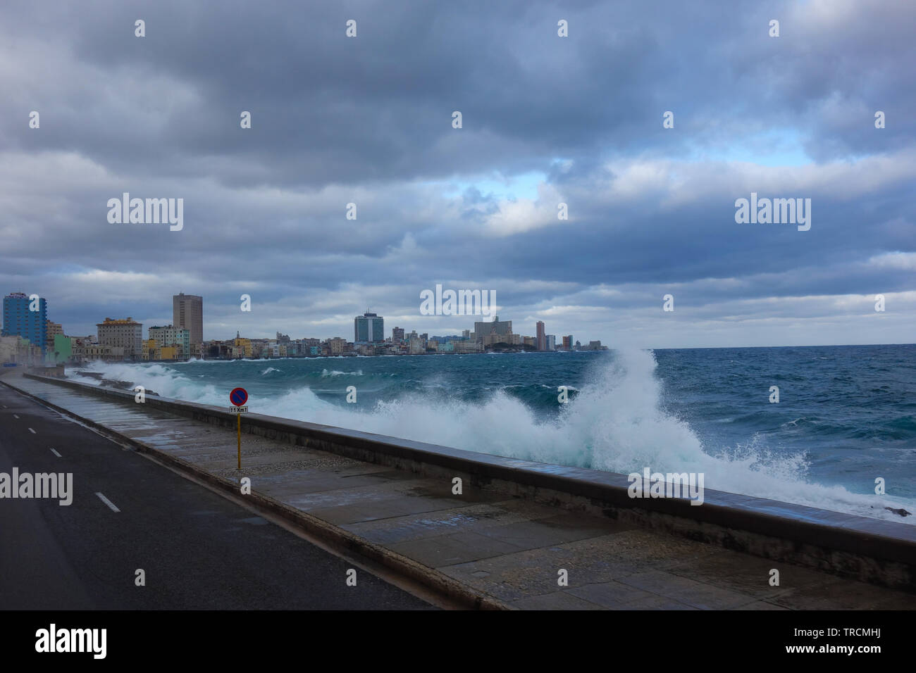 Stormy weather with big waves crashing over the seawall of The Malecon, the famous Havana promenades in Havana, Cuba - Stock Image