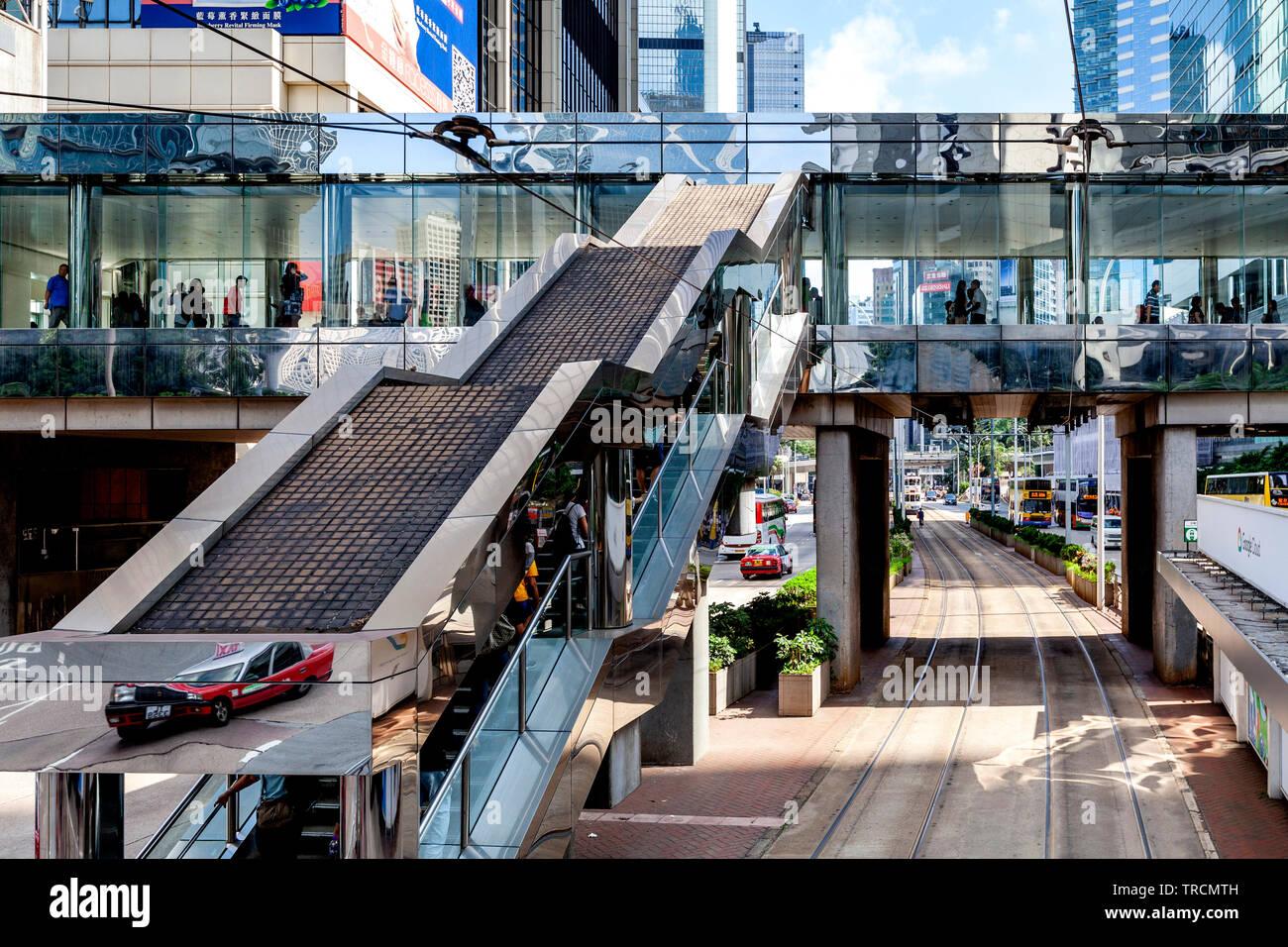 Pedestrian Overpass and Hong Kong Skyline, Hong Kong, China Stock Photo