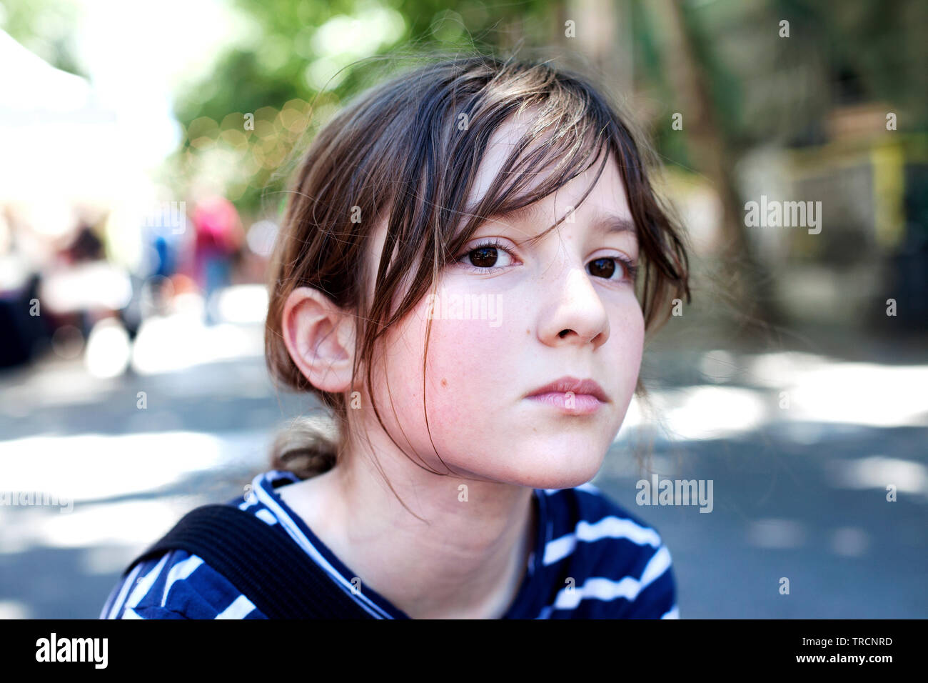Boy looking thoughtful. - Stock Image
