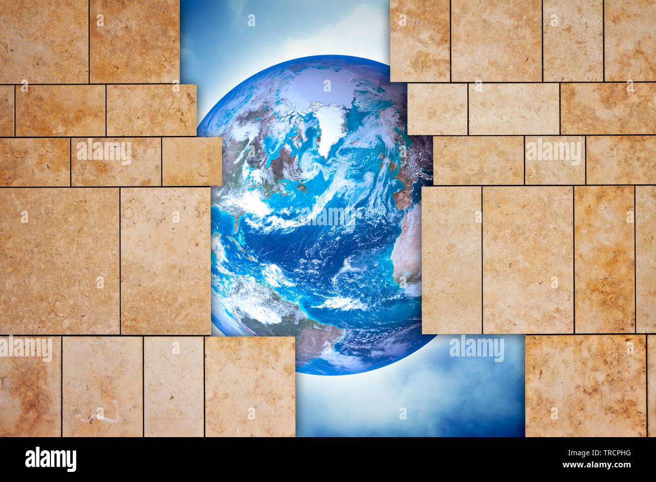 Through a open modern stone wall you can see the world - concept image - Photo composition with elements furnished by NASA - The image of the planet E - Stock Image