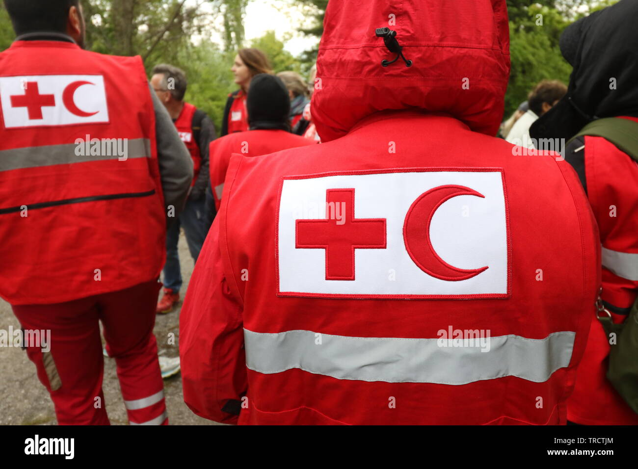 Details with the Red Cross and Red Crescent symbol on a uniform. Red Cross and the Red Crescent, are international humanitarian organizations Stock Photo