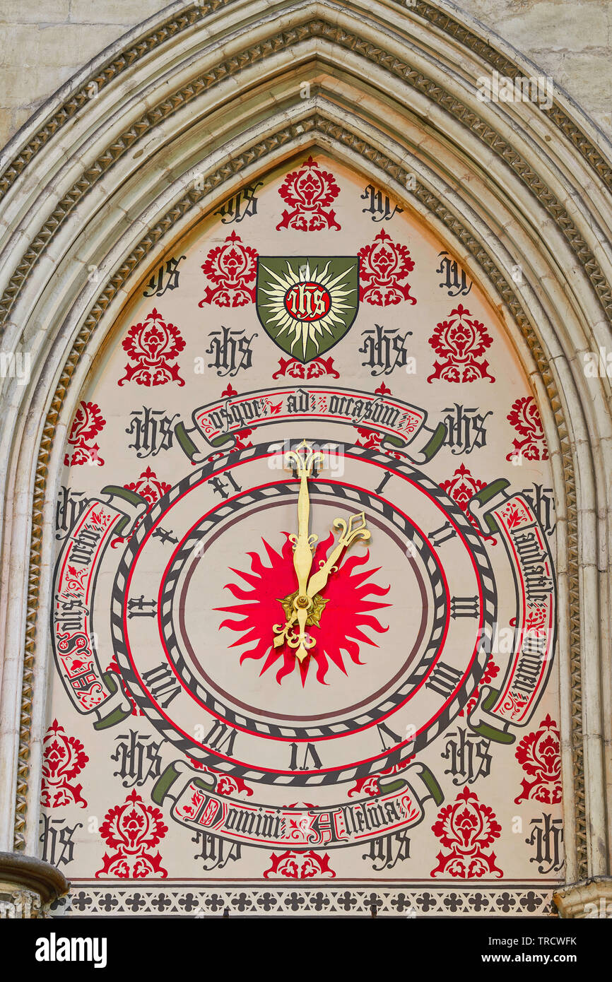 Clock in the north transept of York minster cathedral, England, showing a time of twelve o'clock, midday. - Stock Image