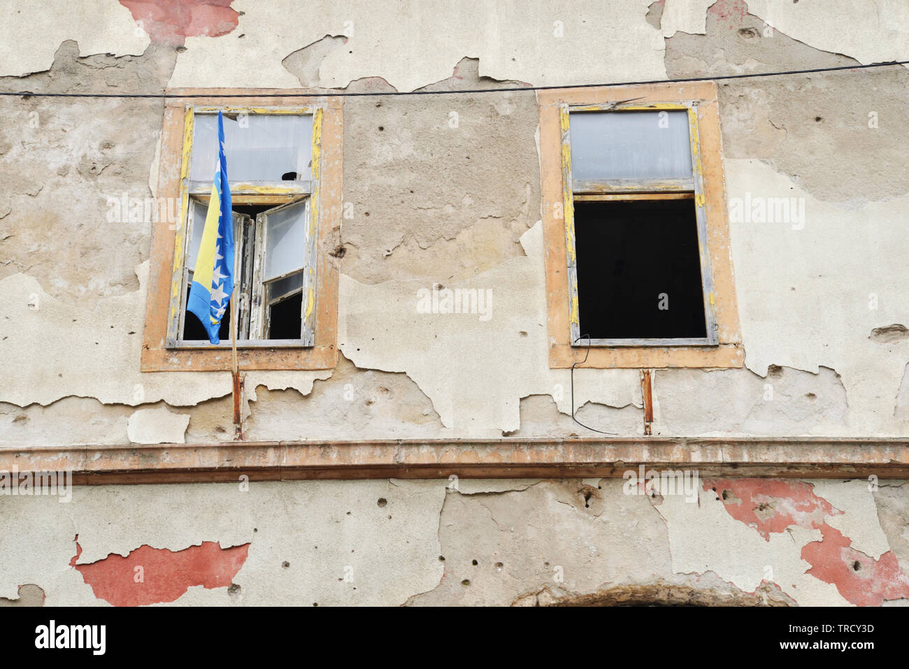 Scars of war in Bosnia still visible on walls of Mostar - Stock Image