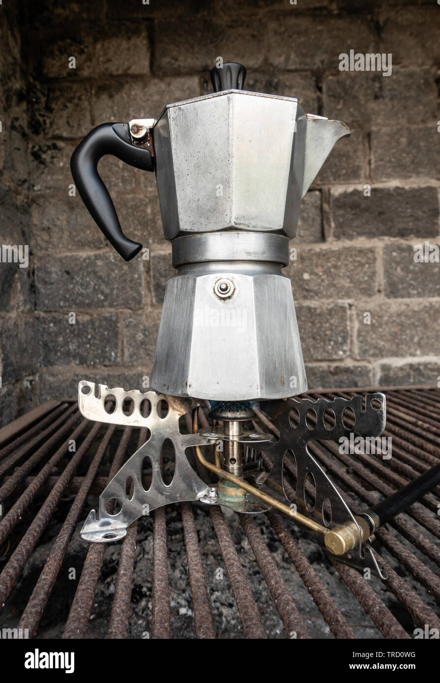 Spanish Cafetera/ Italian Moka coffee maker on camping gas stove. - Stock Image