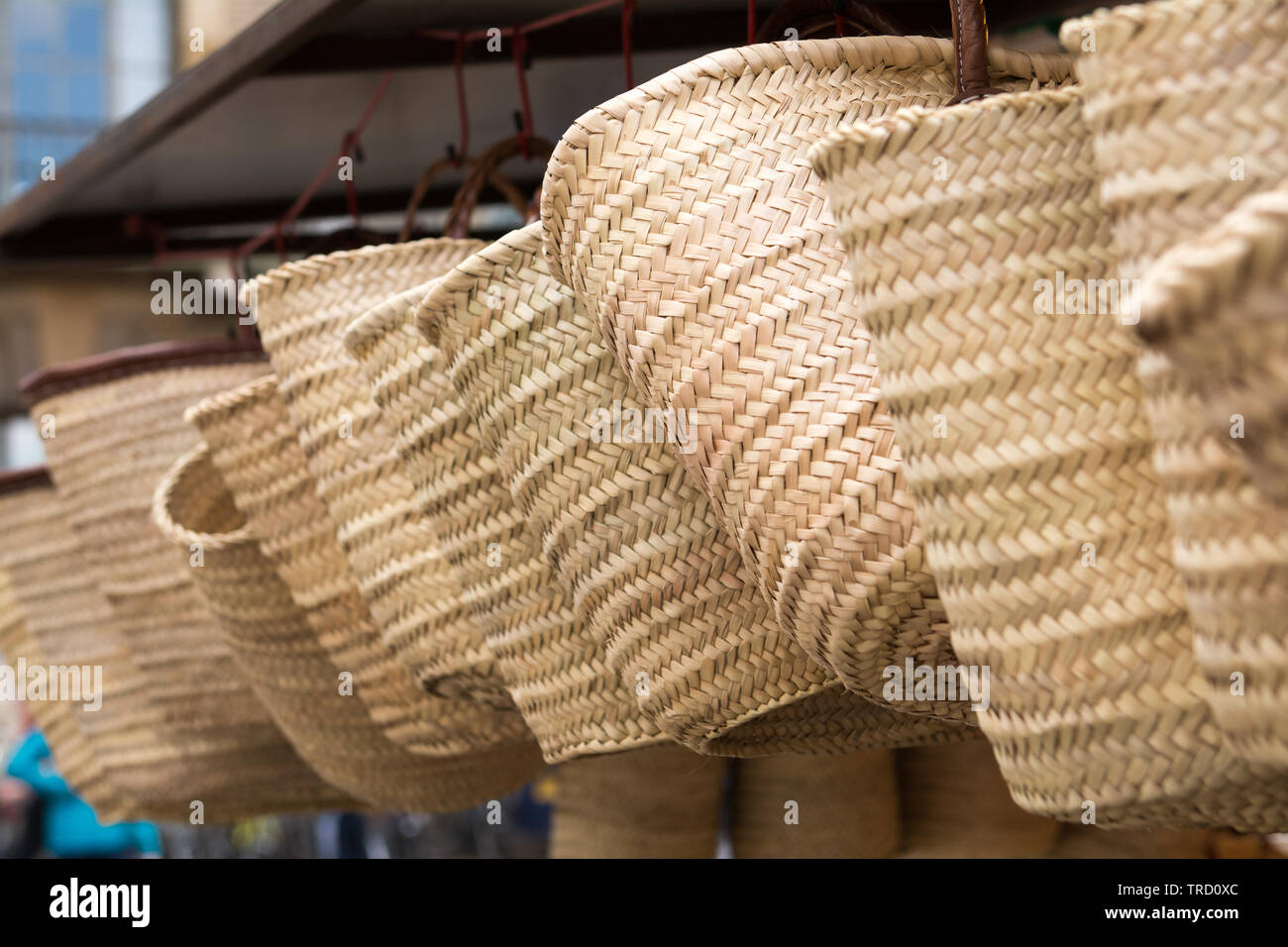 Close up of wicker baskets for sale at local market - Stock Image