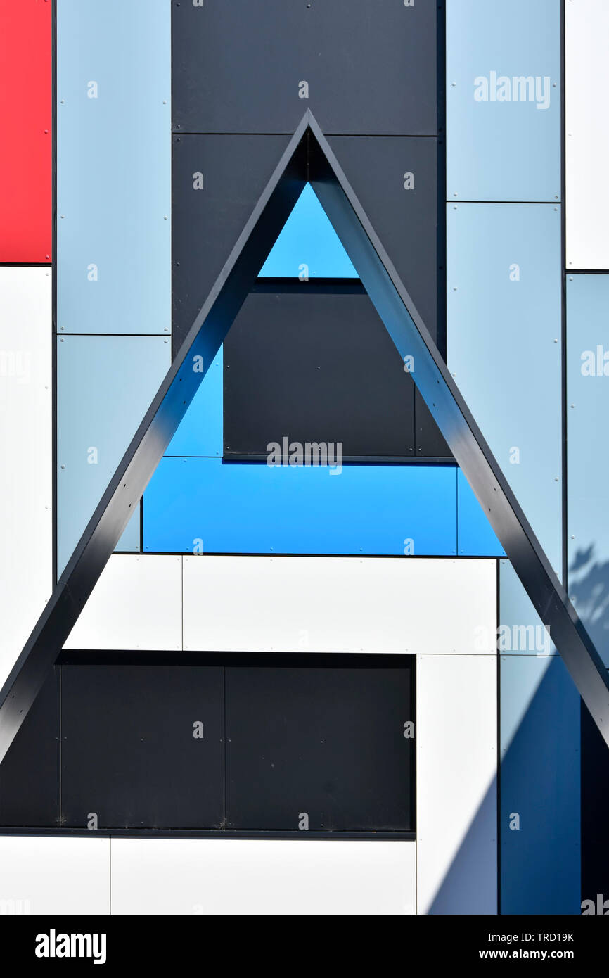 Close up abstract pattern of rectangle & triangle shapes of coloured wall cladding panels on architecture design in modern building England UK Stock Photo
