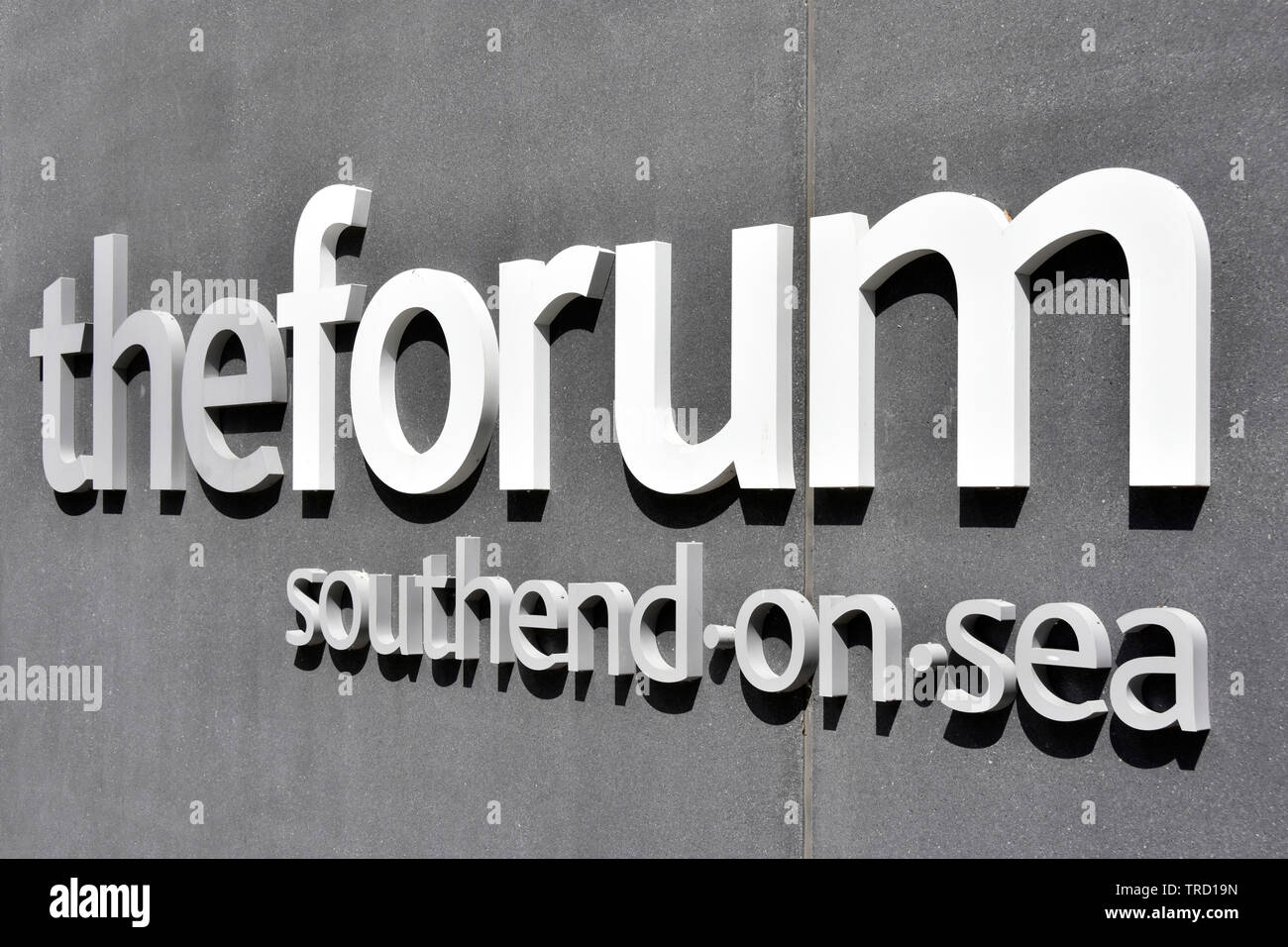 Close up letters in Forum sign on wall of building which has Higher Education learning resources & modern library in Southend on Sea  Essex England UK Stock Photo