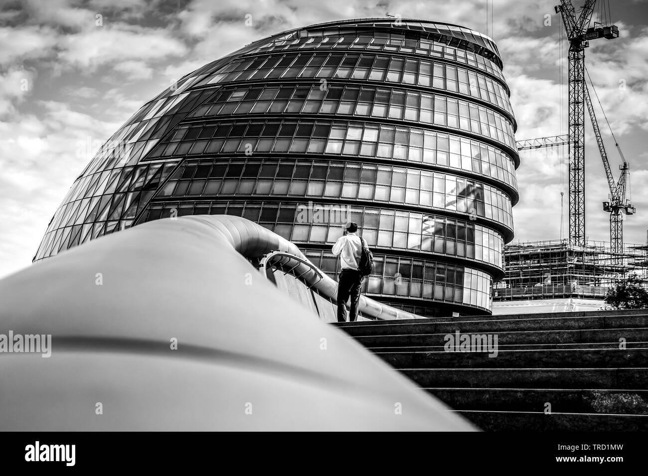 Man standing on the steps of City Hall London - Stock Image