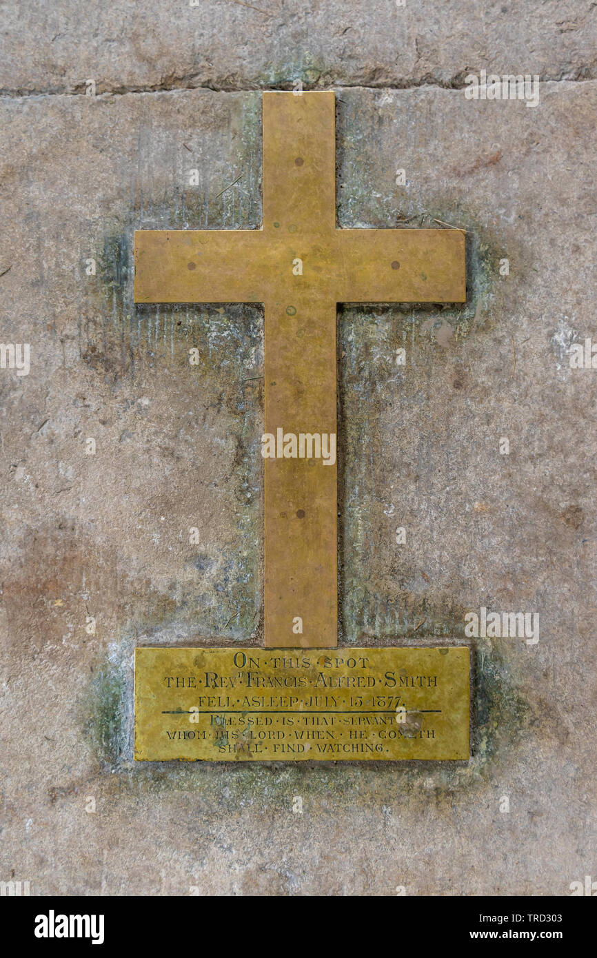 A brass cross on the floor inside St Mary's Church in Tarrant Crawford - a redundant church now in the care of the CCT, Dorset,  UK - Stock Image