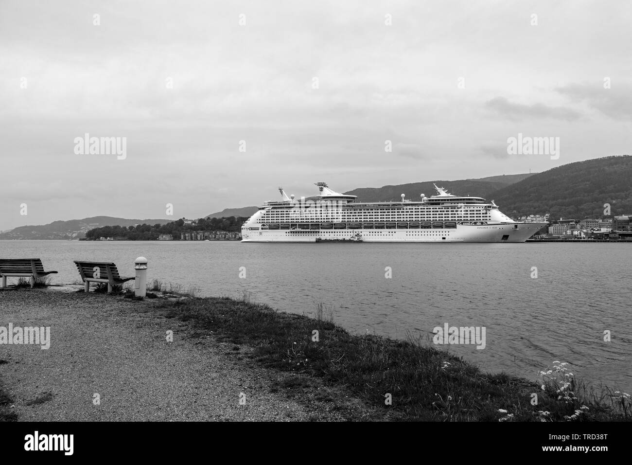 Cruise ship Explorer Of The Seas at Jekteviksterminalen terminal in the port of Bergen, Norway. A rainful and cloudy day. - Stock Image