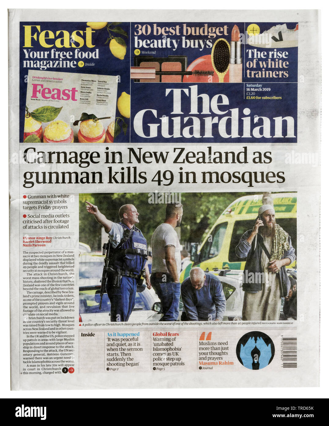 Front page of the Guardian from March 16 2019 with the headline Carnage in New Zealand as Gunman Kills 49 in Mosque - Stock Image