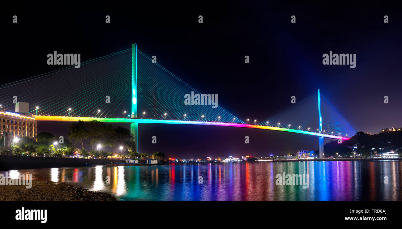 Bai Chay bridge night lights shimmering two peninsula connected Hon Gai and Bai Chay in Ha Long city, Quang Ninh province, Vietnam Stock Photo