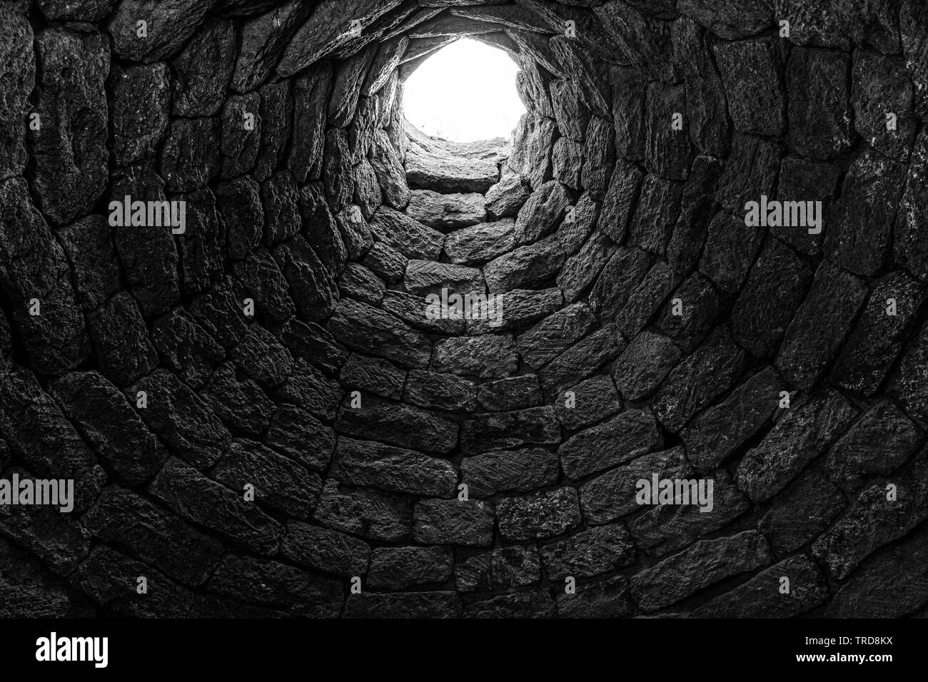 Deep ancient well inside - Stock Image