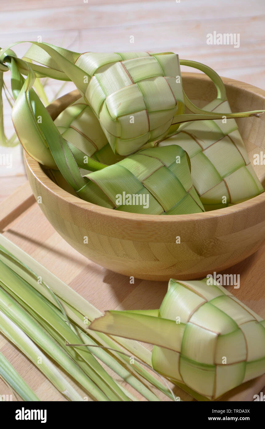 Ketupat, Rice Cake in Diamond Shape Pouch Made from Woven Coconut Leaves - Stock Image
