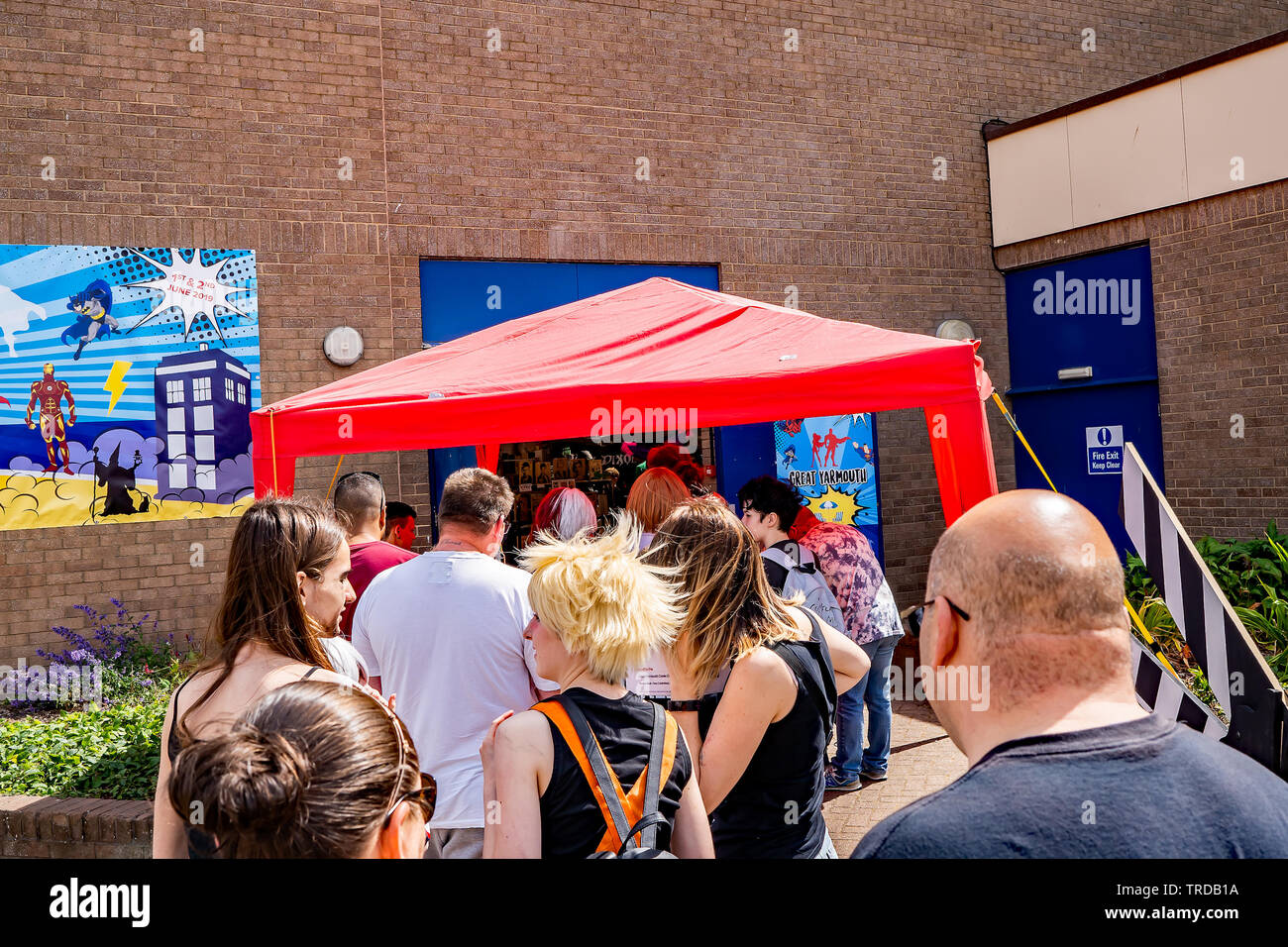 Great Yarmouth Comicon 2019 – Comicon goers and attendees queuing up to enter the Comicon event in the seaside town of Great Yarmouth, Norfolk - Stock Image