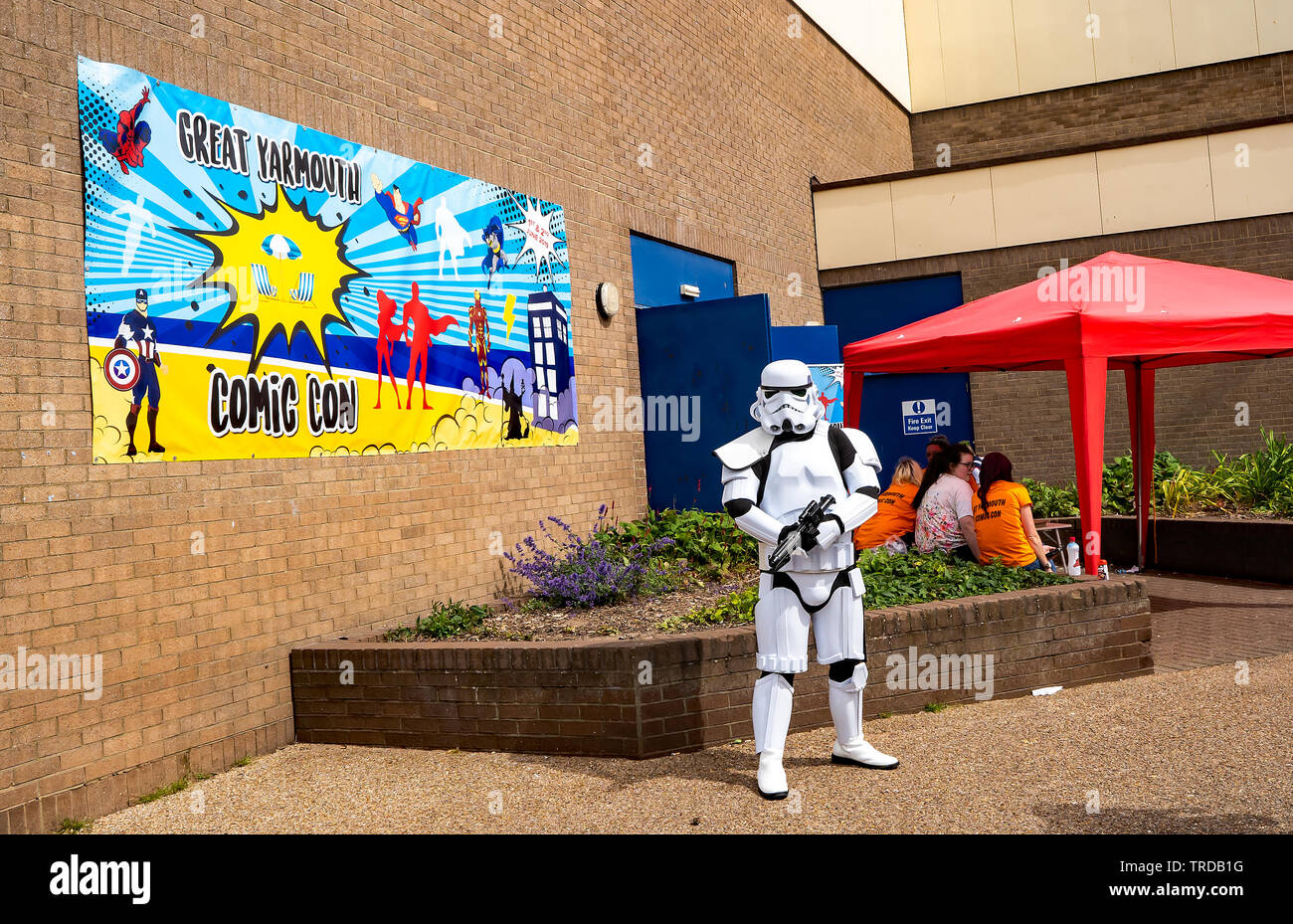 Great Yarmouth Comicon 2019 – Portrait of a man dressed up as a Storm Trooper from the hit Star Wars saga standing outside the entrance to the Comicon - Stock Image