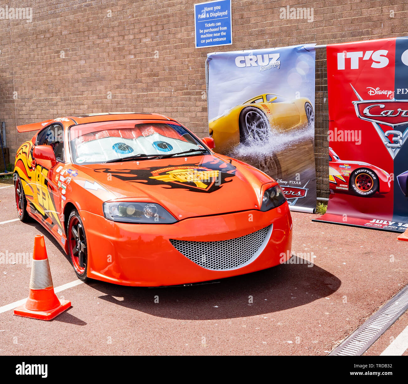 """Great Yarmouth Comicon 2019 – A replica of """"Lightening McQueen"""", one of the cars in the Disney Cars animation, on display at the Comicon event in the - Stock Image"""