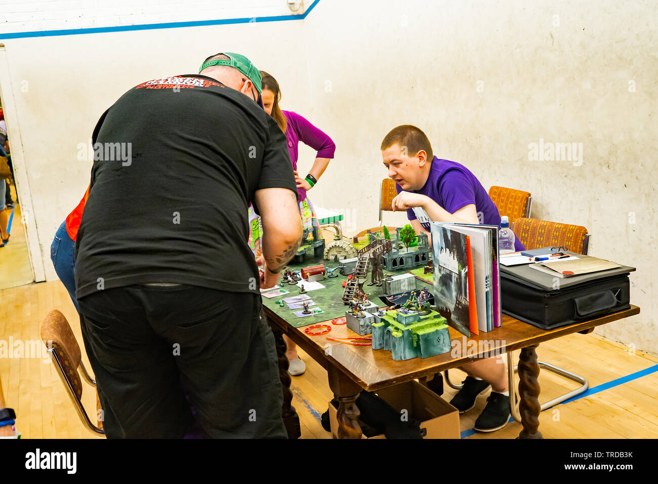 Great Yarmouth Comicon 2019 – Family playing Exodus role playing  game at the Comicon event in the seaside town of Great Yarmouth - Stock Image