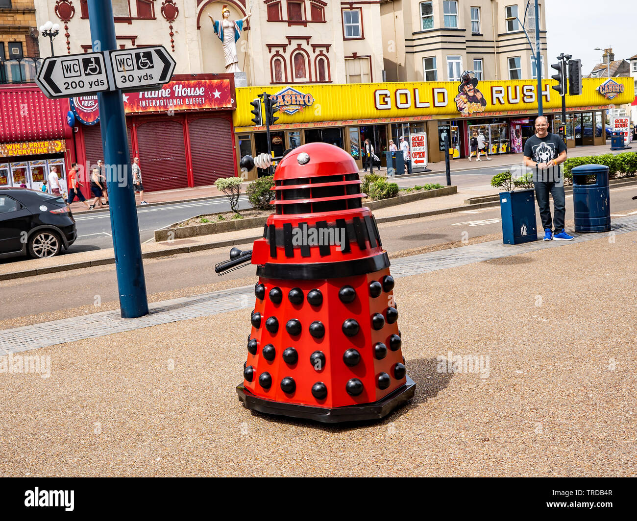 Great Yarmouth Comicon 2019 – A red Dalek used in the Dr Who TV series outside on the streets of Great Yarmouth during a Comicon event held down the s - Stock Image