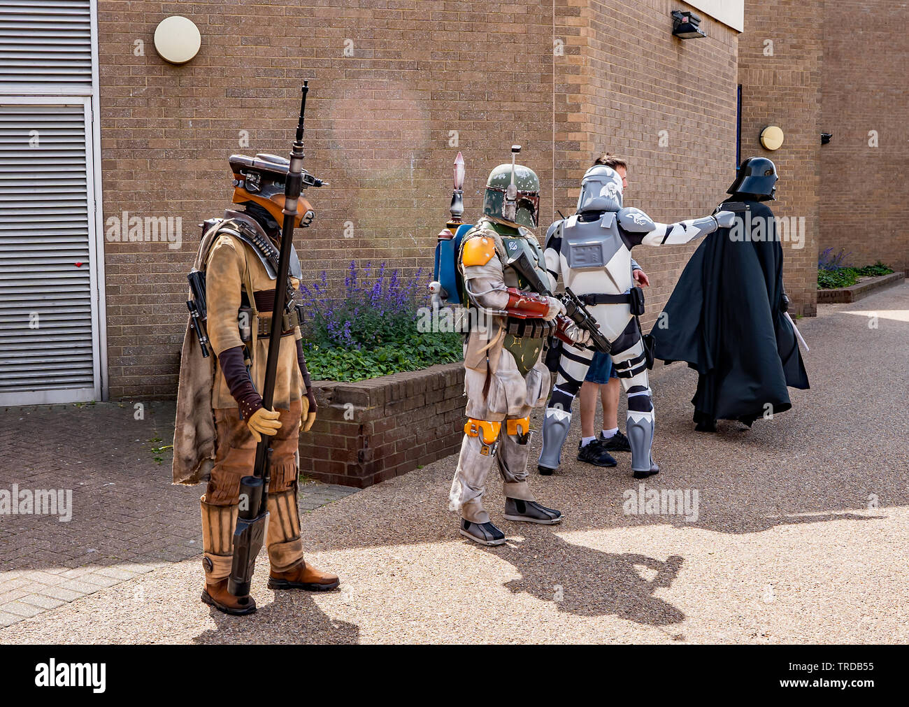 Great Yarmouth Comicon 2019 – Star Wars fans dressed up as Darth Vader and his henchmen henchmen standing outside the Comicon event in the seaside tow - Stock Image