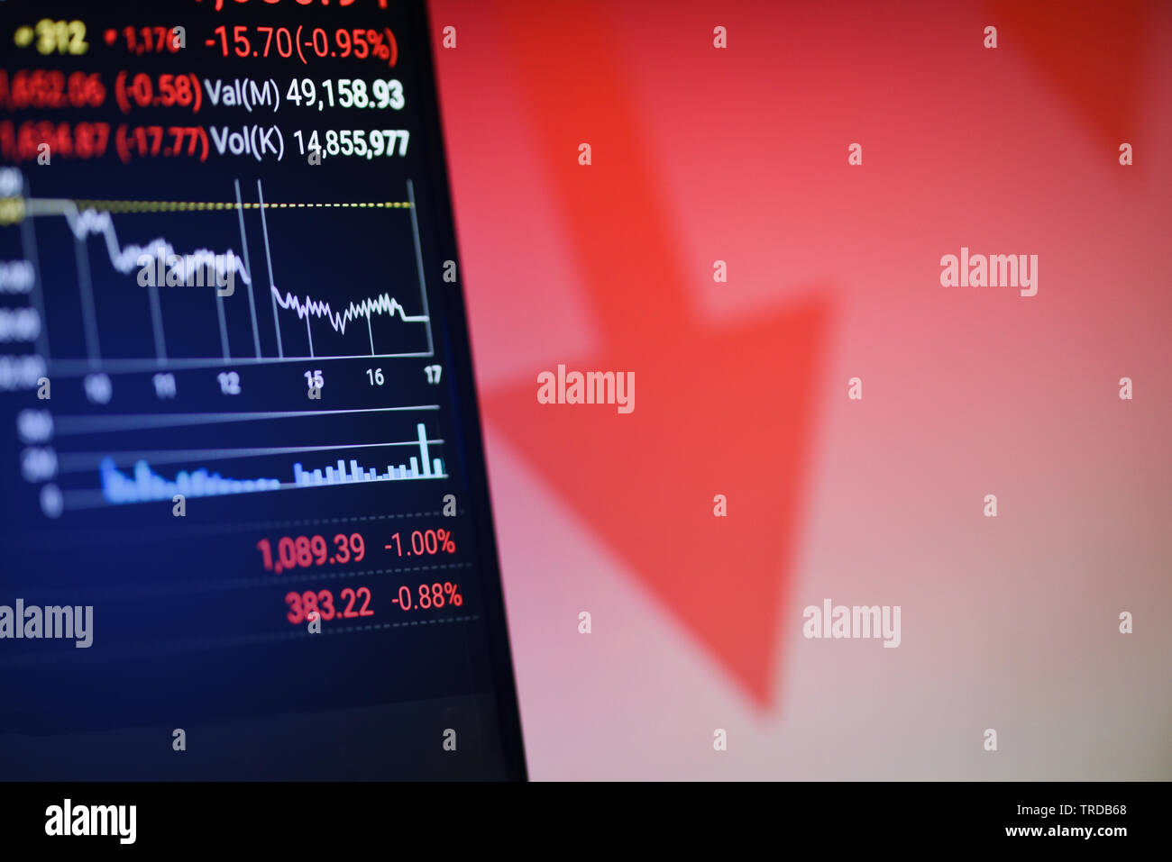 Stock crisis red price drop arrow down chart fall on mobile screen / Stock market exchange analysis graph business and finance money losing moving eco - Stock Image