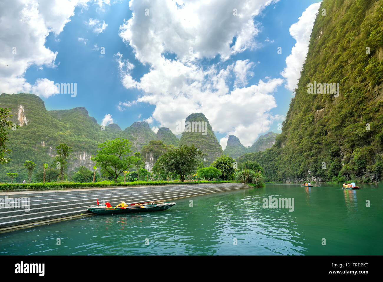 Tourists leaving marina travel to visit Ecotourism the natural landscape in small boat along the river Stock Photo