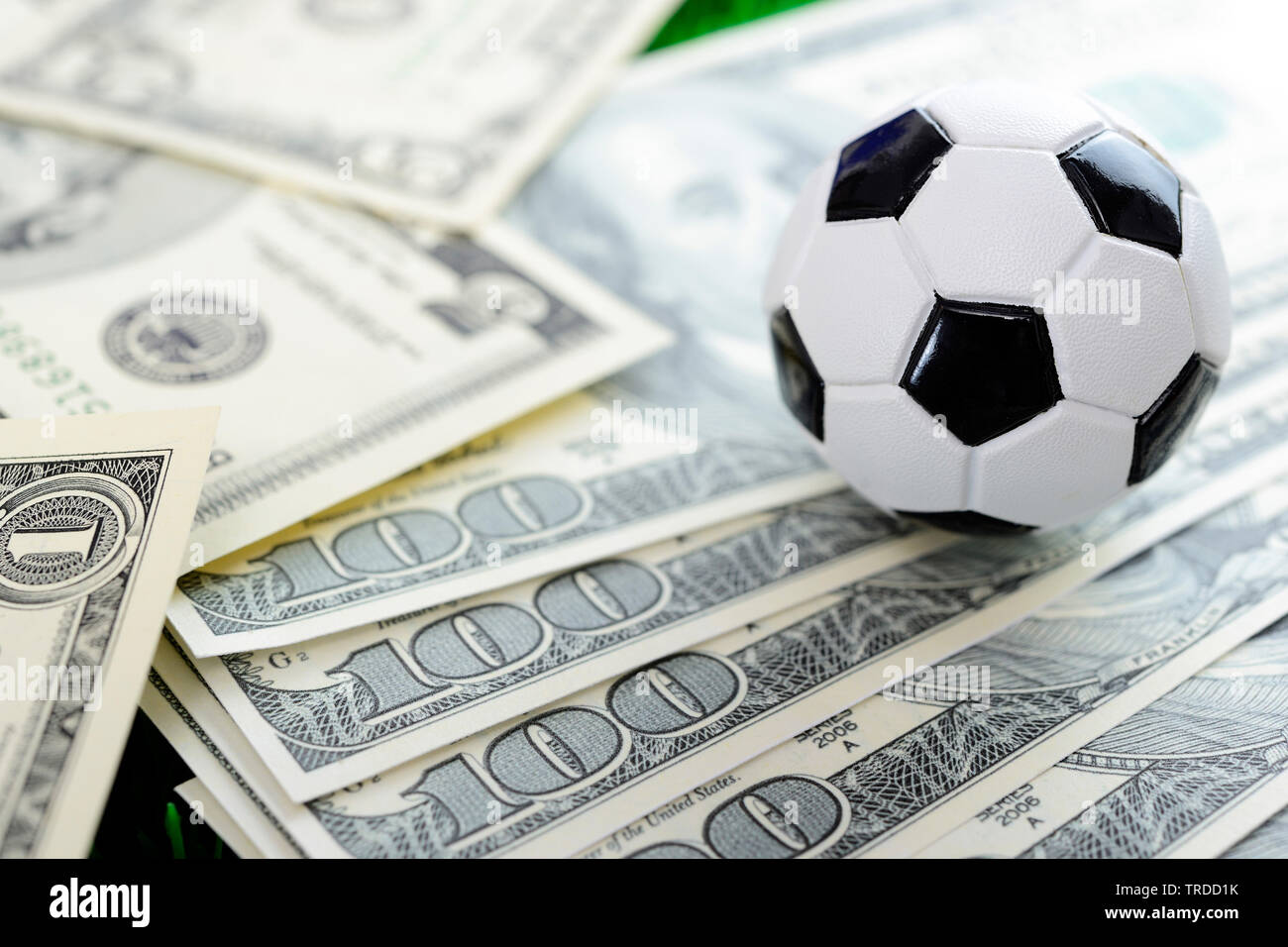 football and dollar bills, FIFA scandal - Stock Image