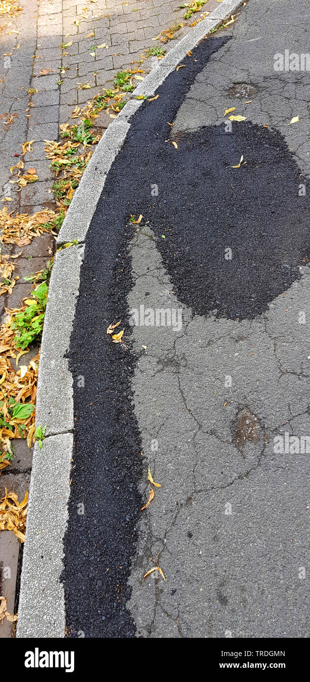 rough patched pavement , Germany Stock Photo