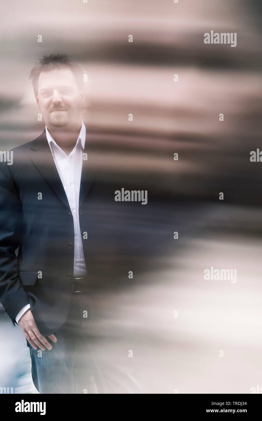 man covered in an motion blur, Germany - Stock Image