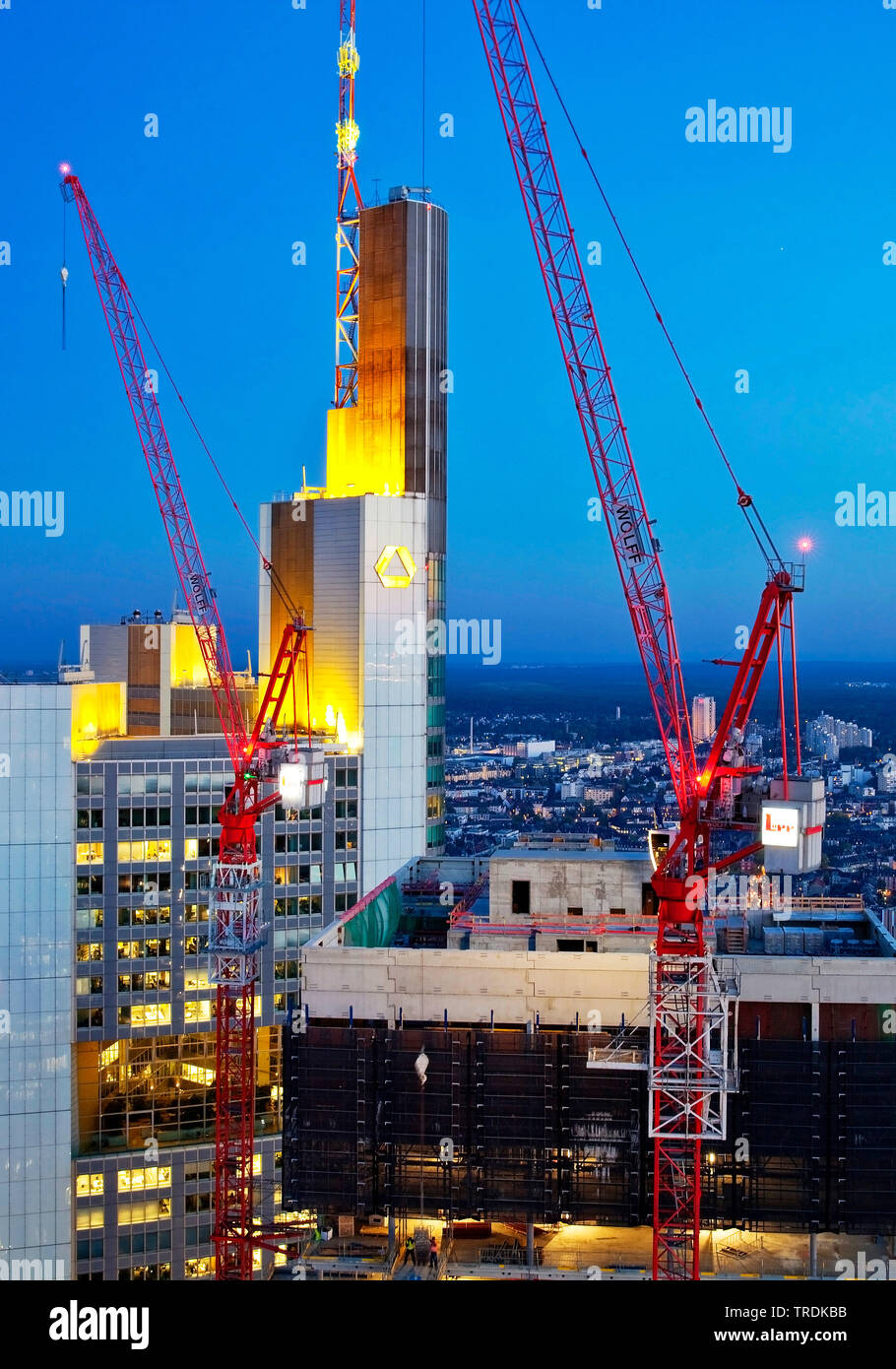 construction site in the financial district next to Commerzbank tower block and Taunus Tower in evening light, Germany, Hesse, Frankfurt am Main Stock Photo