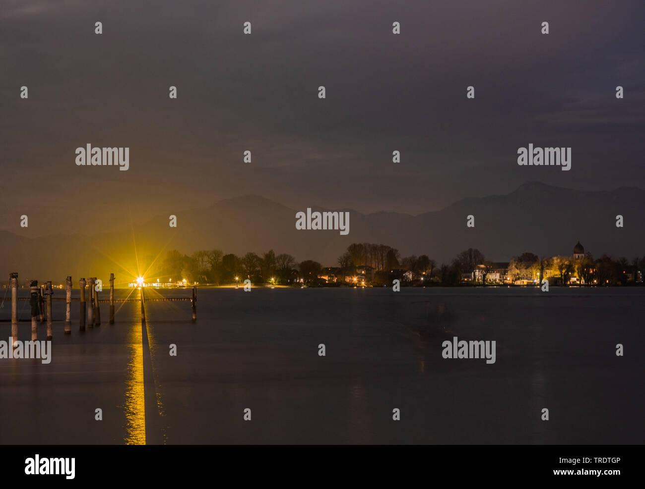 island Frauenchiemsee at night, the Alps in background, Germany, Bavaria, Lake Chiemsee Stock Photo