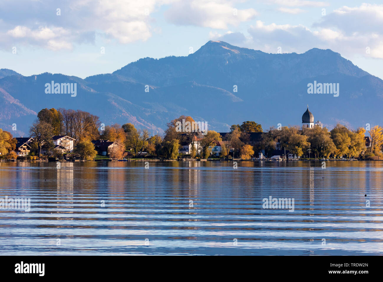 island Frauenchiemsee in front of the Alps in autumn, Germany, Bavaria, Lake Chiemsee Stock Photo