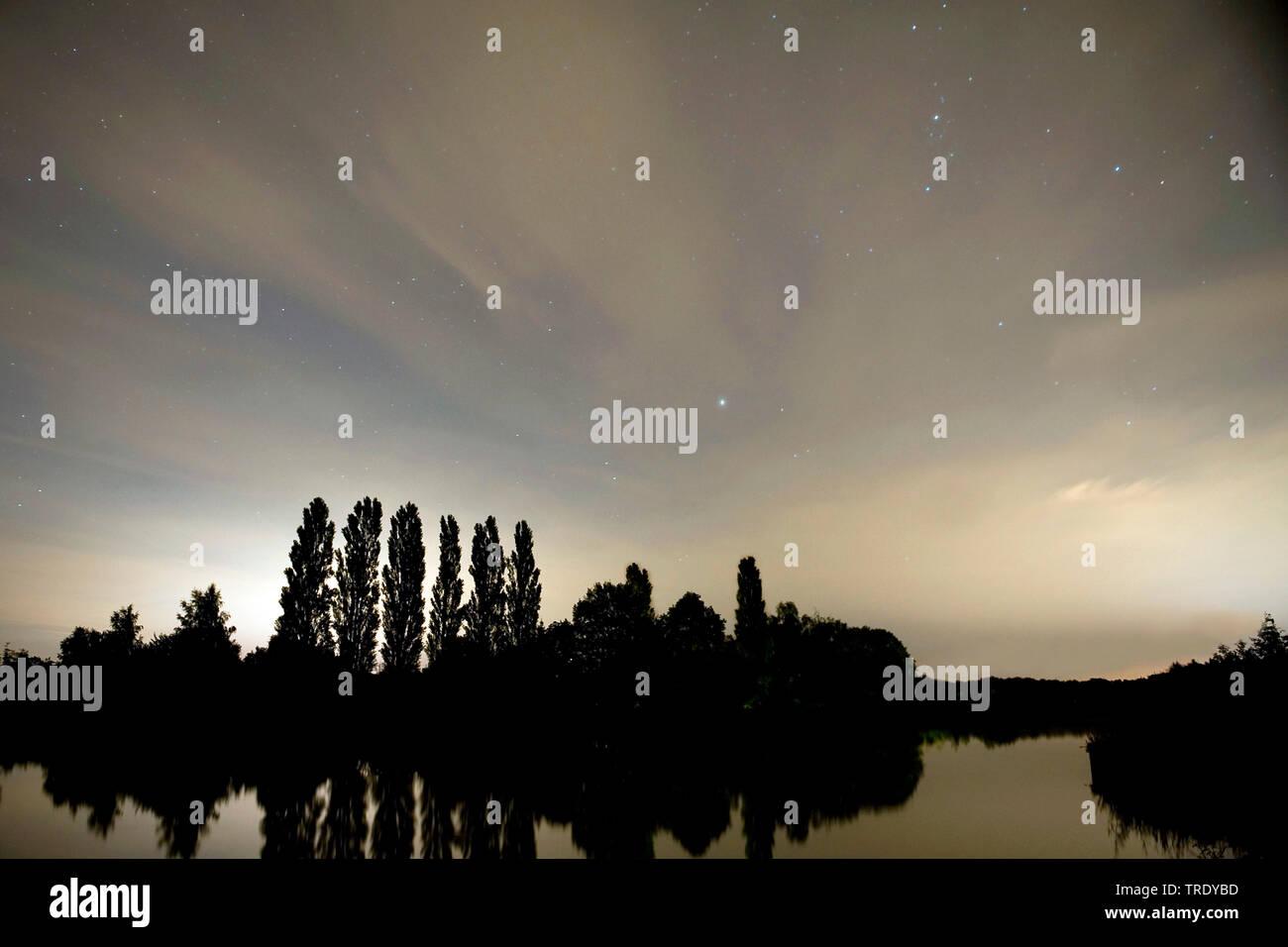 starry night with perseids and cirrus clouds, Netherlands, Overijssel, Twentekanaal Goor, Goor Stock Photo