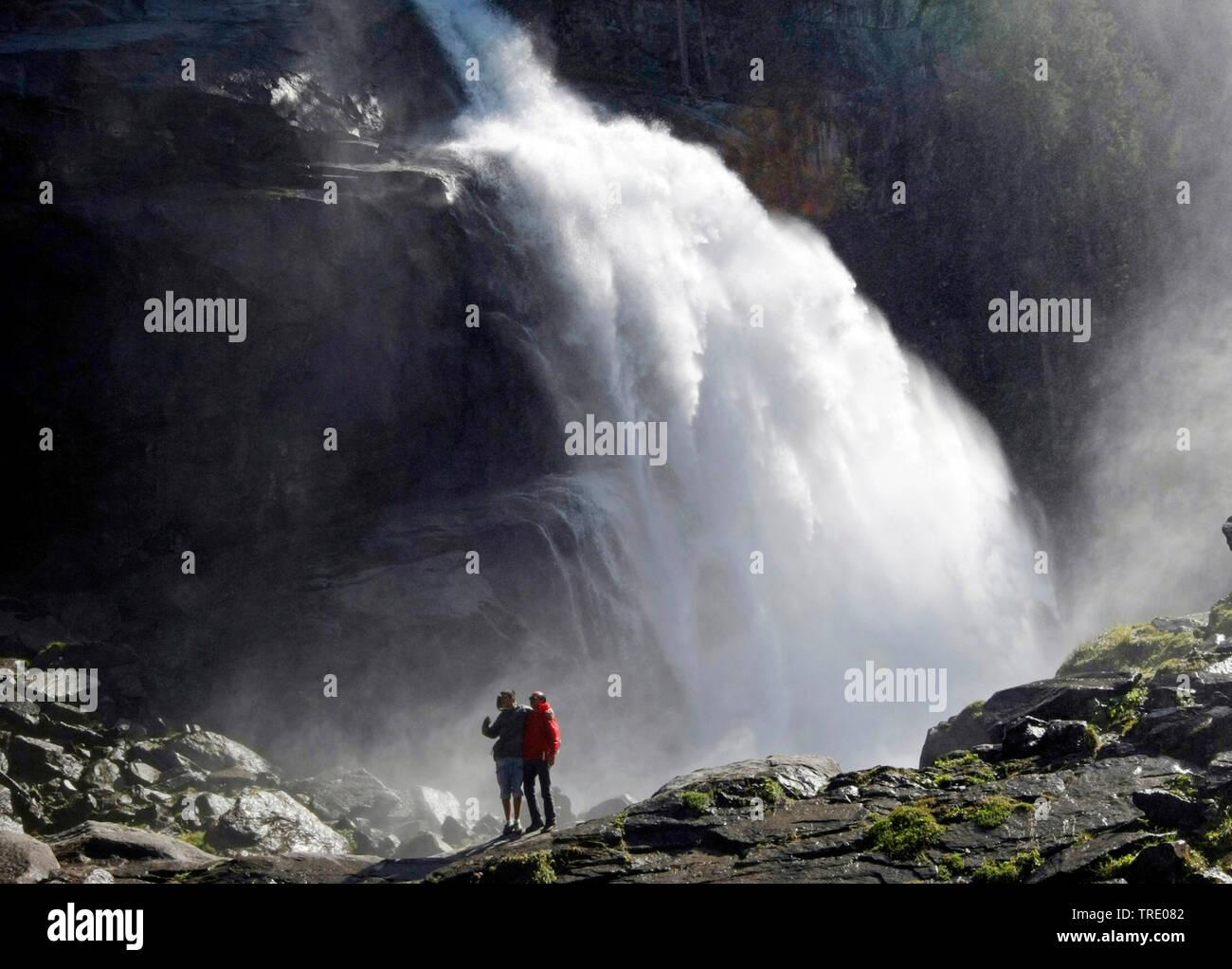 Two montain hiker in front of the Krimml Waterfalls in Salzburg state, Austria, Salzburger Land, Krimml Stock Photo