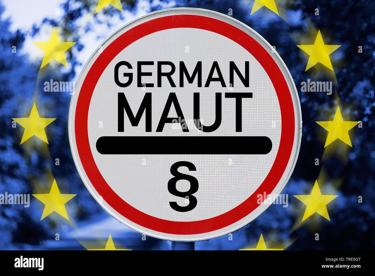 Verbotsschild GERMAN MAUT (Deutsche Maut-Gebuehr) vor einer Europaflagge , Deutschland | Prohibition sign GERMAN MAUT (German road toll) in front of a - Stock Image